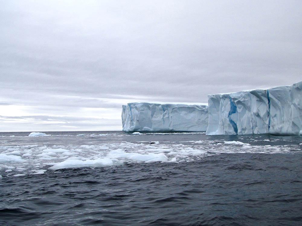 A giant iceberg in the ocean.