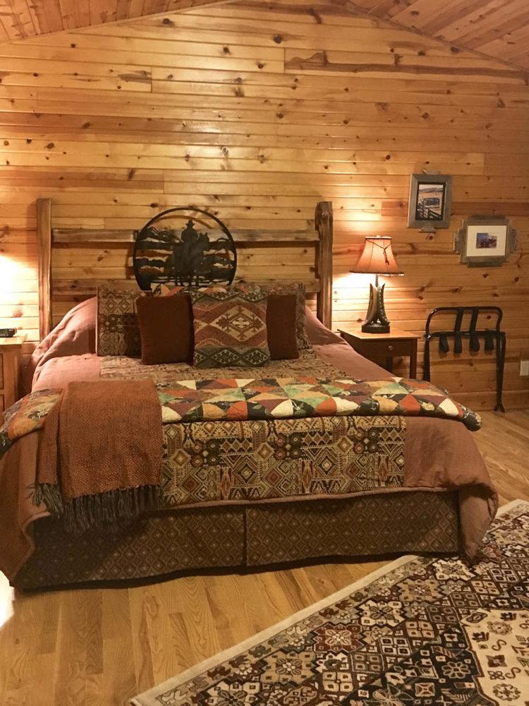 Western styled cabin bedroom at Kickapoo Valley Ranch.