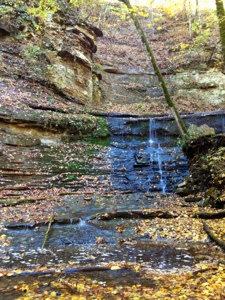 Tiny waterfall running down rocky wall on the Natchez Trace near Nashville.