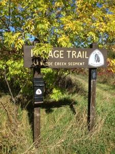 "Large wooden sign saying, ""Ice Age Trail La Budde Creek Segment."""