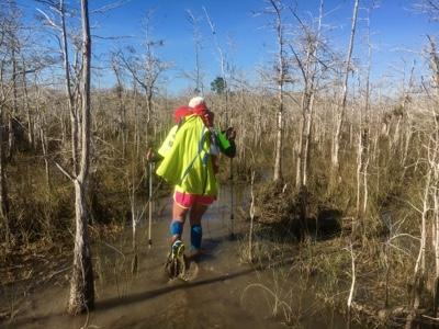 Backpacker hiking in Big Cypress Swamp waters.