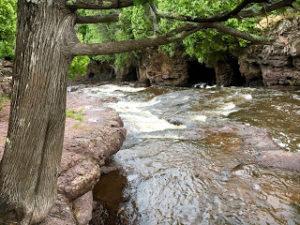 River rushing near a hiking trail.