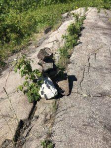 Rock cairn set on a rocky outcrop.