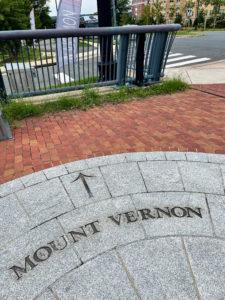 Concrete sidewalk inset saying