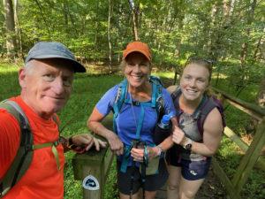 Three hikers standing on a bridge on the PHT near Algonkian Park.